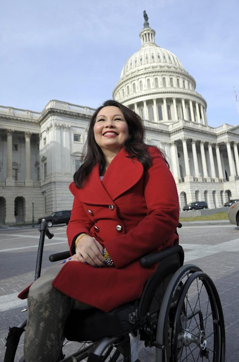 Rep.-elect Tammy Duckworth, D-Ill. is seen on Capitol Hill in Washington, Thursday, Jan. 3, 2013, as she poses with other female House members prior to the official opening of the 113th Congress. (AP 