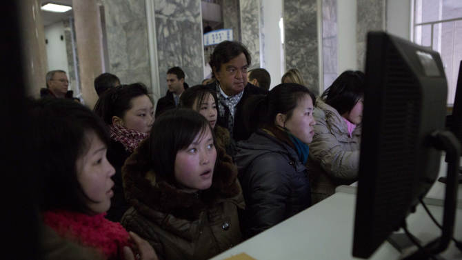 Former New Mexico Bill Richardson, back row center,  watches North Koreans working on computers at the Grand Peoples Study House in Pyongyang, North Korea on Wednesday, Jan. 9, 2013. Richardson and Executive Chairman of Google, Eric Schmidt, toured the facility. (AP Photo/David Guttenfelder)
