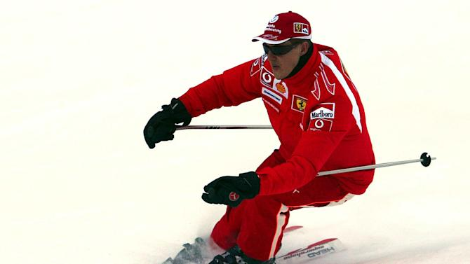 In this Thursday, Jan. 12, 2006 file photo provided by the Ferrari press office, Formula One driver Michael Schumacher of Germany speeds down a course in the Madonna di Campiglio ski resort, in the Italian Alps . French radio says retired Formula One champion Michael Schumacher has been injured in a skiing accident. RMC radio reported Sunday Dec. 29, 2013 that the seven-time champion had fallen while skiing off-piste at the French Alpine resort of Meribel. The radio quoted resort director Christophe Gernigon-Lecomte as saying that Schumacher was wearing a helmet when he fell and hit a rock. (AP Photo/Ferrari, File)
