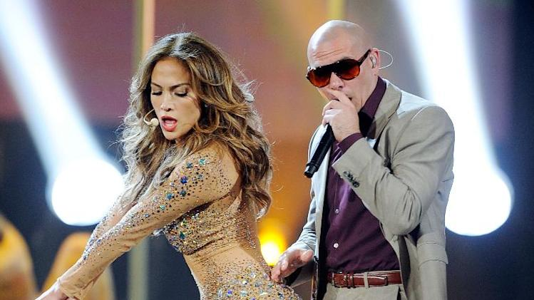 Singer Jennifer Lopez and rapper Pitbull perform on November 20, 2011 in Los Angeles, California