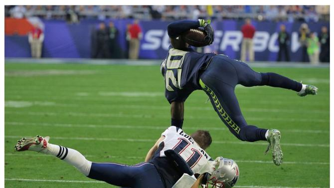 A combination photo shows Seattle Seahawks Jeremy Lane being tackled by New England Patriots Julian Edelman during the NFL Super Bowl XLIX football game in Glendale, Arizona