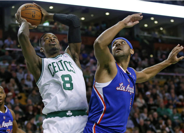 Boston Celtics guard Jeff Green (8) shoots against Los Angeles Clippers forward Jared Dudley in the first quarter of an NBA basketball game in Boston, Wednesday, Dec. 11, 2013