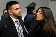 Stephanie Kercher (R) and Lyle Kercher, the siblings of late Meredith Kercher, look on after the verdict in the retrial of Raffaele Sollecito and Amanda Knox for murder on January 30, 2014