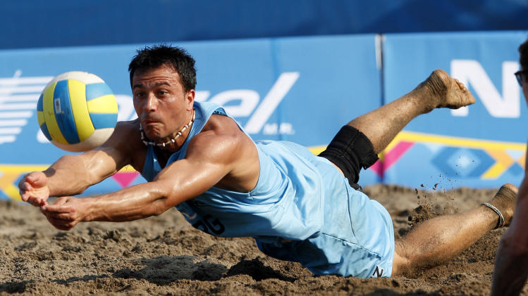 Argentina's Pablo Suarez reaches for the ball during a men's beach volleyball quarterfinal match against the United States at the Pan American Games in Puerto Vallarta, Mexico, Thursday Oct. 20, 2011. Argentina won 2-0. (AP Photo/Ariana Cubillos)