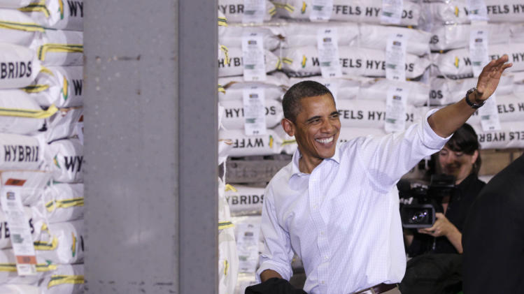 President Barack Obama waves as he leaves a town hall meeting, Wednesday, Aug. 17, 2011, at Wyffels Hybrids Inc., in Atkinson, Ill., during his three-day economic bus tour.  (AP Photo/Carolyn Kaster)