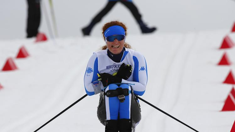 Francesca Porcellato of Italy races during the ladies 12km cross country ski, sitting event at the 2014 Winter Paralympic, Sunday, March 9, 2014, in Krasnaya Polyana, Russia. (AP Photo/Dmitry Lovetsky)