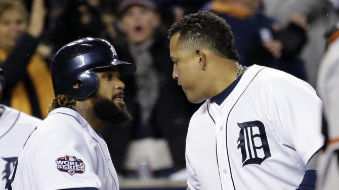 Detroit Tigers' Prince Fielder congratulates Miguel Cabrera after Cabrera's two-run home run during the third inning of Game 4 of baseball's World Series against the San Francisco Giants Sunday, Oct. 28, 2012, in Detroit. (AP Photo/David J. Phillip)