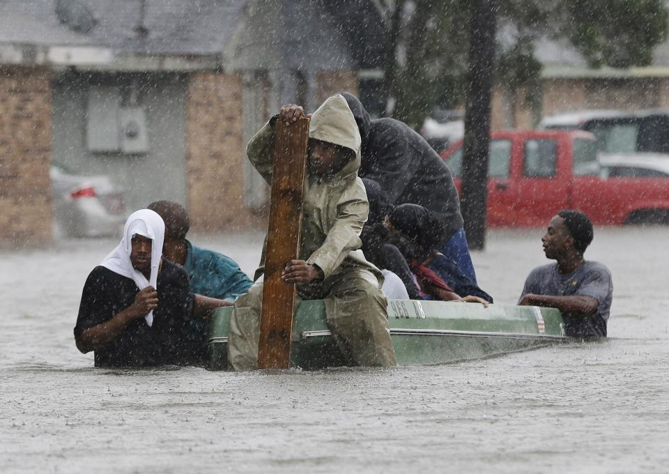 Residents evacuate their flooded neighborhood, Thursday, Aug. 30, 2012, in LaPlace, La.  Isaac staggered toward central Louisiana early Thursday, its weakening winds still potent enough to drive storm surge into portions of the coast and the River Parishes between New Orleans and Baton Rouge. (AP Photo/Eric Gay)
