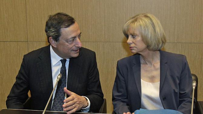 "European Central Bank head Mario Draghi, left, speaks with foreign affairs commission president Elisabeth Guigou prior to the hearing at the French National Assembly in Paris, Wednesday June 26, 2013. Mario Draghi says the bank has ""done as much as it can"" to stabilize Europe's troubled economy and that now it's up to national governments to reform their economies. (AP Photo/Remy de la Mauviniere)"