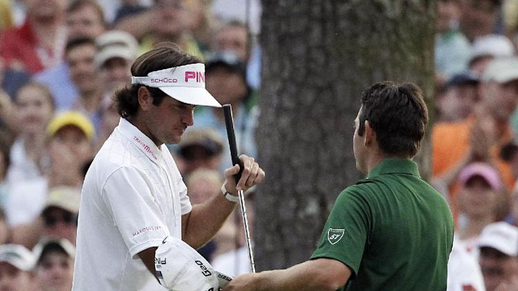Bubba Watson is congratulated by Louis Oosthuizen, of South Africa, after winning the Masters golf tournament following a sudden death playoff on the 10th hole Sunday, April 8, 2012, in Augusta, Ga. (AP Photo/Chris O'Meara)