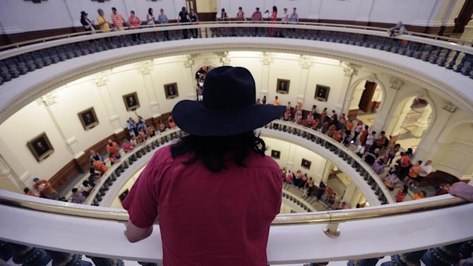 Hundreds line up to enter the Senate Chamber spills into multiple levels of the rotunda as Sen. Wendy Davis, D-Fort Worth, filibusters in an effort to kill an abortion bill, Tuesday, June 25, 2013, in Austin, Texas. The bill would ban abortion after 20 weeks of pregnancy and force many clinics that perform the procedure to upgrade their facilities and be classified as ambulatory surgical centers. (AP Photo/Eric Gay)