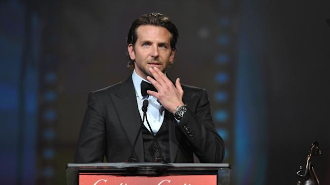 Bradley Cooper appears on stage at the 24th Annual Palm Springs International Film Festival Awards Gala on Saturday, Jan. 5, 2013 in Palm Springs, Calif. The gala honors individuals in the film industry with awards for acting, directing, achievement in film scoring and lifetime achievement. (Photo by John Shearer/Invision/AP Images)