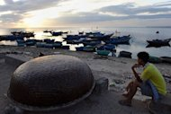 A fisherman looks out at the sea from a fishing beach in Ly Son Island off the central province of Quang Ngai in August 2012