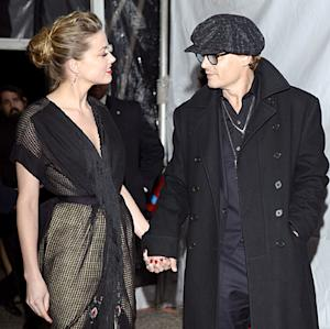 Amber Heard Flashes Huge Engagement Ring With Johnny…
