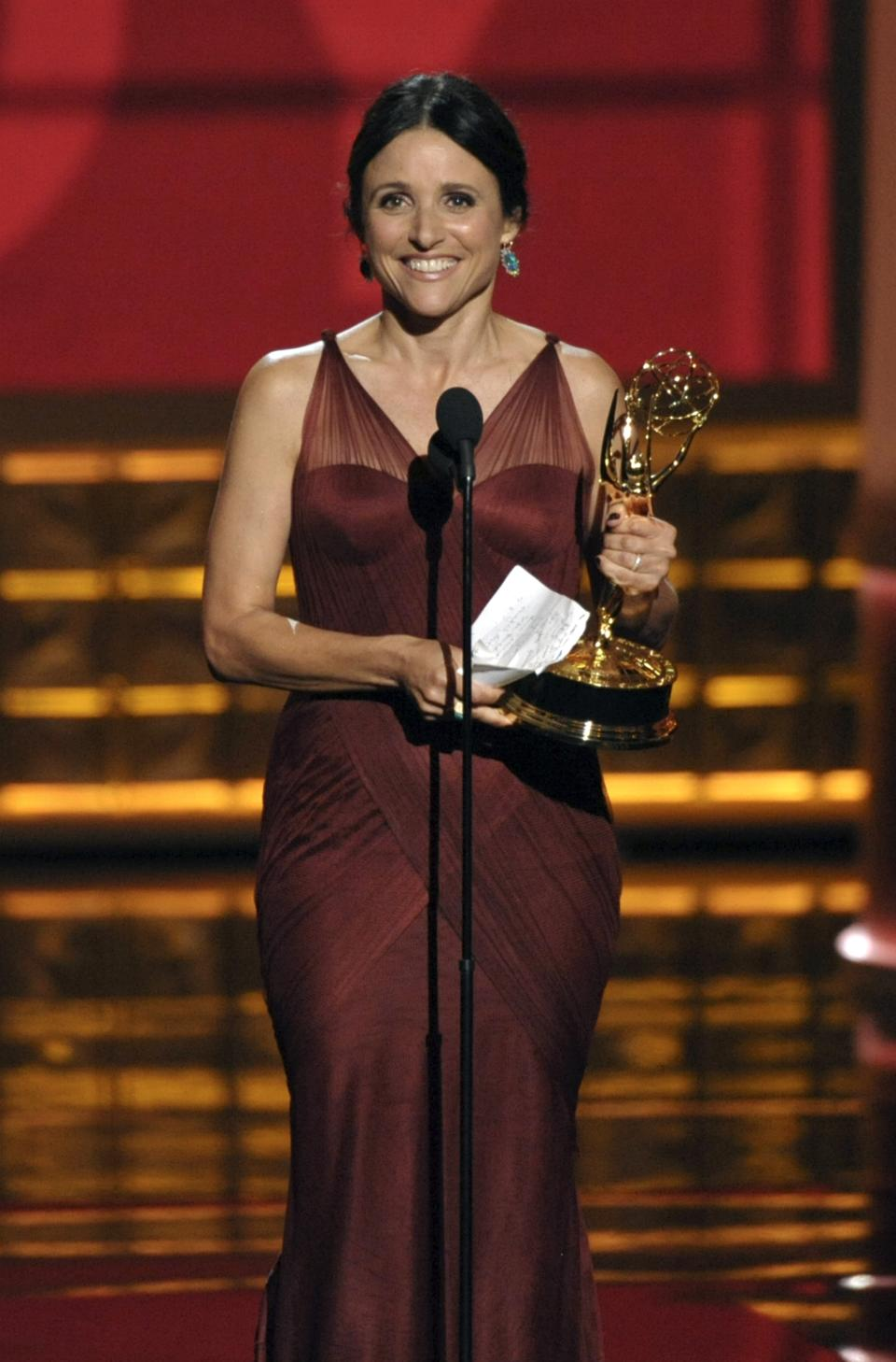 "Julia Louis-Dreyfus accepts the award for Outstanding Lead Actress in a Comedy Series for ""Veep"" at the 64th Primetime Emmy Awards at the Nokia Theatre on Sunday, Sept. 23, 2012, in Los Angeles. (Photo by John Shearer/Invision/AP)"