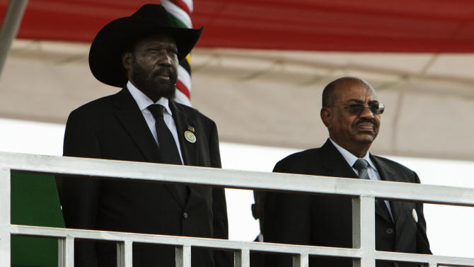 South Sudan's president Salva Kiirr, left, and Sudan's President Omar al-Bashir stand on the podium at the start of independence celebrations in Juba, South Sudan, Saturday, July 9, 2011. South Sudan raised the flag of its new nation for the first time on Saturday, as thousands of South Sudanese citizens swarmed the capital of Juba to celebrate the country's birth. (AP Photo/David Azia)