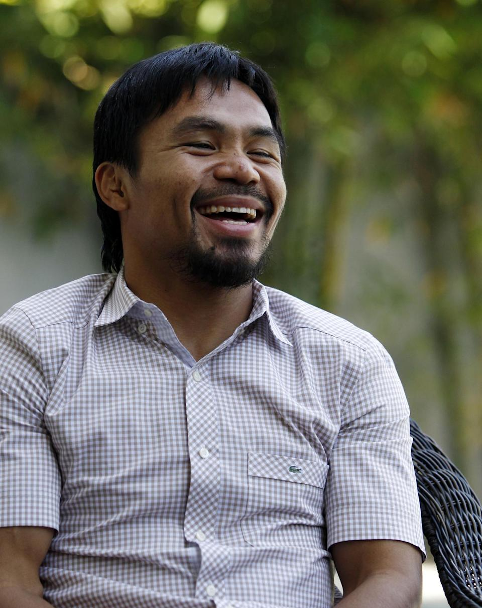 Boxer and politician Manny Pacquiao speaks about his views on same-sex marriage at his home in Los Angeles, Wednesday, May 16, 2012. Pacquiao was quoted in a recent interview as opposing President Barack Obama's views on same-sex marriage. (AP Photo/Reed Saxon)
