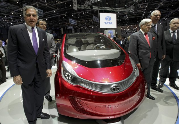 Tata Motors' Chairman Ratan Tata (L) poses in front of the Megapixel model car during the first media day of the Geneva Auto Show at the Palexpo in Geneva