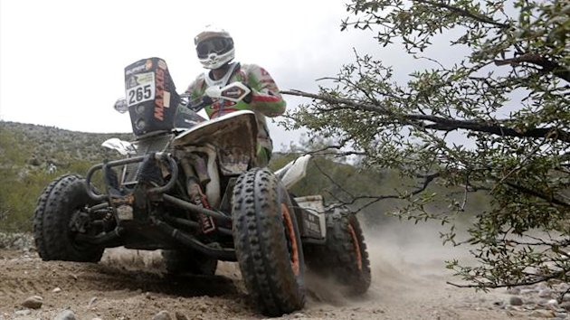 United Arab Emirates' Sebastian Husseini rides his Honda quad (Reuters)