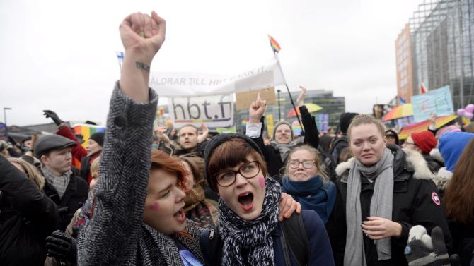 Supporters of same-sex marriage celebrate outside the Finnish Parliament in Helsinki