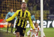 Borussia Dortmund's Jakub Blaszczykowski celebrates a goal against Shakhtar Donetsk during their Champions League soccer match in Dortmund March 5, 2013. REUTERS/Ina Fassbender