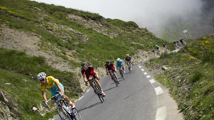 Italy's Vincenzo Nibali wearing the overall leader's yellow jersey rides in the pack during the eighteenth stage of the Tour de France cycling race on July 24, 2014 between Pau and Hautacam