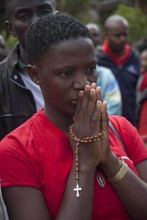 A Christian faithful prays near the Holy Family Basilica …