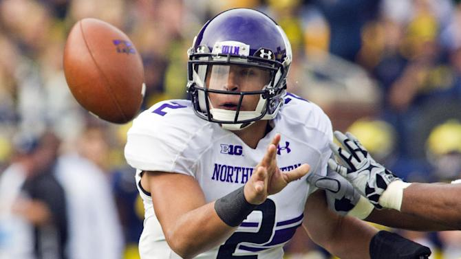 Northwestern quarterback Kain Colter (2) pitches the ball towards a running back during the first quarter of an NCAA college football game against Michigan, Saturday, Nov. 10, 2012, in Ann Arbor, Mich. (AP Photo/Tony Ding)