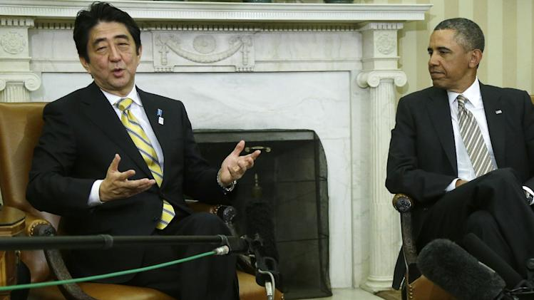 President Barack Obama listens as Japan's Prime Minister Shinzo Abe answers a question from a reporter in the Oval Office of the White House in Washington, Friday, Feb. 22, 2013. (AP Photo/Charles Dharapak)