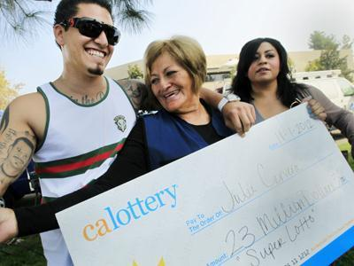 Raw: Woman claims $23M prize just in time