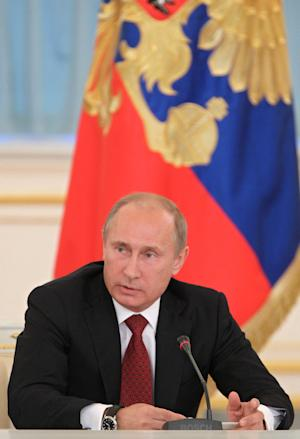 Russian President Vladimir Putin chairs a meeting with members of the Presidential Council on culture and art in the Kremlin in Moscow, Tuesday, Sept. 25, 2012. (AP Photo/RIA-Novosti, Mikhail Klimentyev, Presidential Press Service)