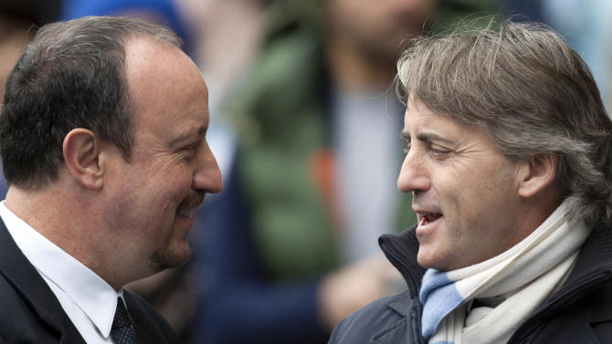 Manchester City's manager Roberto Mancini, right, greets Chelsea's manager Rafa Benitez before their English Premier League soccer match at The Etihad Stadium, Manchester, England, Sunday Feb. 24, 2013. (AP Photo/Jon Super)