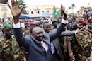 Central African Republic&#039;s new leader Michel Djotodia greets his supporters at a rally in downtown Bangui