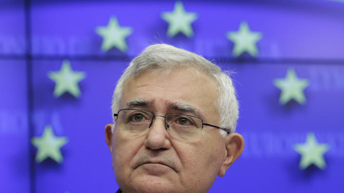 File - In this Jan. 24, 2011 file photo, European Commissioner for Health and Consumer Policy John Dalli addresses the media during an EU agriculture and fisheries council, at the European Council building in Brussels. EU Health Commissioner John Dalli on Tuesday, Oct. 16, 2012 resigned over corruption allegations involving tobacco legislation but denies any wrongdoing. Tuesday's resignation came after the EU's anti-fraud office found that he was aware of an attempt at corruption in pushing new legislation on the EU export ban on the tobacco product snus. (AP Photo/Yves Logghe. File)