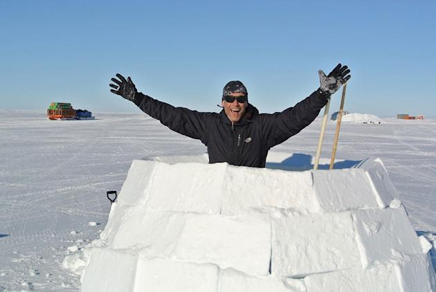 Michael builds an igloo as the team waits for the plane to be fixed.