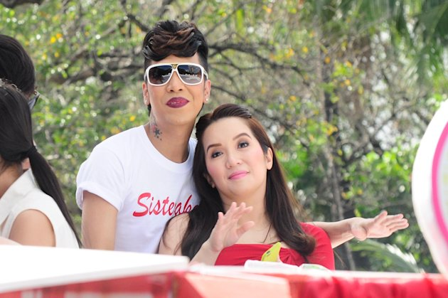 "Vice Ganda and Kris Aquino are seen at the float of the MMFF 2012 entry, ""Sisterekas"" during the 2012 Metro Manila Film Festival Parade of Stars on 23 December 2012.(Angela Galia/NPPA Images)"