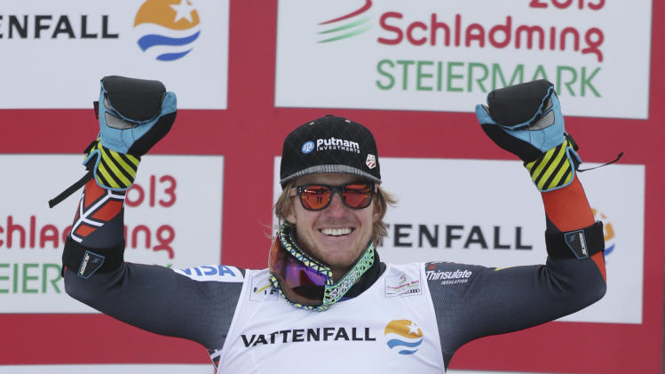 United States' Ted Ligety celebrates winning the men's super-G at the Alpine skiing world championships in Schladming, Austria, Wednesday, Feb.6,2013. (AP Photo/Matthias Schrader)