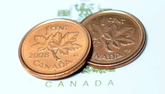 Pennies are shown in Ottawa on Thursday, March 29, 2012. The humble one-cent piece is set to disappear from Canadian pockets, a victim of inflation. Thursday&#39;s federal budget said the Royal Canadian Mint will strike the last of the little coins this fall. Responses Friday were mixed, with some Canadians saying it would make life easier, while others worried it would become an opening for sneaky price hikes. (AP Photo/The Canadian Press, Sean Kilpatrick)