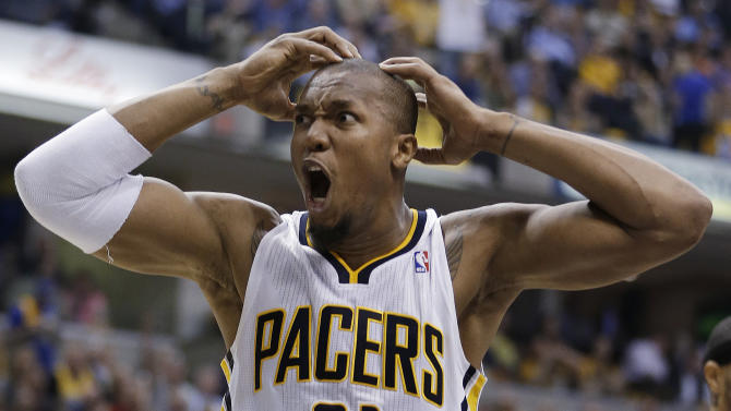 Indiana Pacers' David West reacts after teammate Roy Hibbert was called for a foul during the first half of Game 4 of an Eastern Conference semifinal NBA basketball playoff series against the New York Knicks, on Tuesday, May 14, 2013, in Indianapolis. (AP Photo/Darron Cummings)