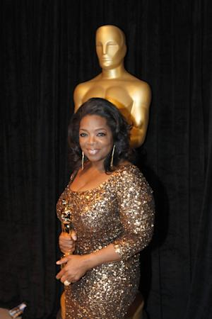 Oprah Winfrey poses with her honorary Oscar at the 84th Academy Awards on Sunday, Feb. 26, 2012, in the Hollywood section of Los Angeles. (AP Photo/Chris Carlson)