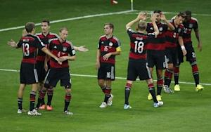 Germany's players celebrate after their teammate Klose scored his team's second goal against Brazil during their 2014 World Cup semi-finals at the Mineirao stadium in Belo Horizonte