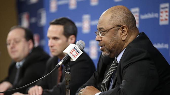 Former major league player Bob Watson, right, talks about the selections made to the baseball Hall of Fame by the pre-integration era committee at the baseball winter meetings on Monday, Dec. 3, 2012, in Nashville, Tenn. Former New York Yankees owner Jacob Ruppert, longtime umpire Hank O'Day and barehanded catcher Deacon White have been elected to the baseball Hall of Fame by the committee. (AP Photo/Mark Humphrey)
