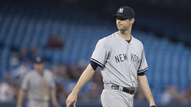 New York Yankees relief pitcher Chris Martin reacts before being pulled during eighth inning MLB baseball action against the Toronto Blue Jays in Toronto on Monday, May 4, 2015.   (Darren Calabrese/The Canadian Press via AP)   MANDATORY CREDIT