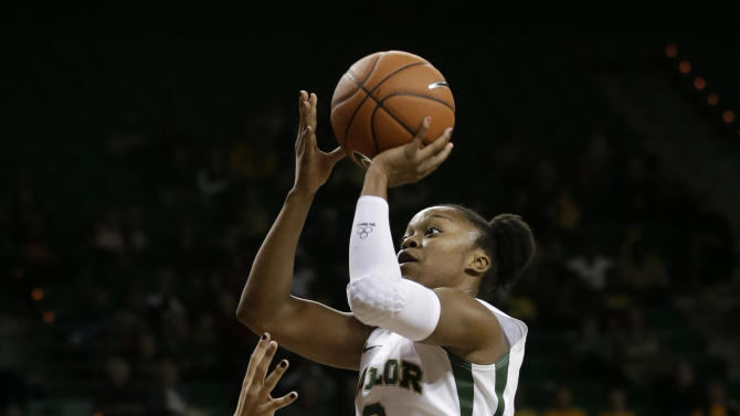 FILE - In this Dec. 12, 2012 file photo, Baylor guard Odyssey Sims (0) attempts a shot as Oral Roberts guard Kevi Luper, rear, watches in the second half of an NCAA college basketball game in Waco, Texas. Sims was selected to the 2012-13 AP Women'sAll-America team, Tuesday, April 2, 2013. (AP Photo/Tony Gutierrez, File)