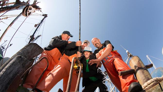 """This publicity image released by the National Geographic Channel shows the four of the captains from the series, """"Wicked Tuna,"""" posing on a pier in Gloucester, Mass. The channel faces the challenge of trying to build a successful network in the era of Honey Boo-Boo and """"Duck Dynasty"""" without damaging a National Geographic brand that has stood for quality since the magazine was first published in 1888. The first three months of 2013 was the network's most popular quarter since its launch in 2001. The National Geographic Channel averaged 554,000 viewers in prime time, propelled by """"Doomsday Preppers,"""" the """"Wicked Tuna"""" series about fishermen in Gloucester, Mass., and a movie dramatization of Bill O'Reilly's book, """"Killing Lincoln.""""  (AP Photo/National Geographic Channel)"""