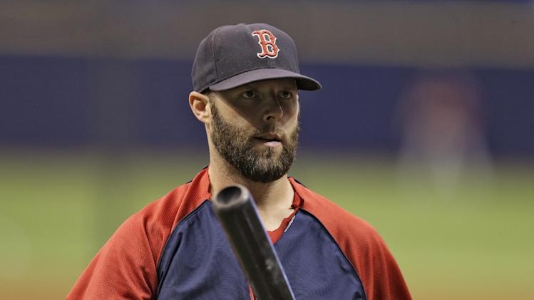 Boston Red Sox's Dustin Pedroia waits to take batting practice before a baseball game against the Tampa Bay Rays Friday, July 25, 2014, in St. Petersburg, Fla. (AP Photo/Chris O'Meara)