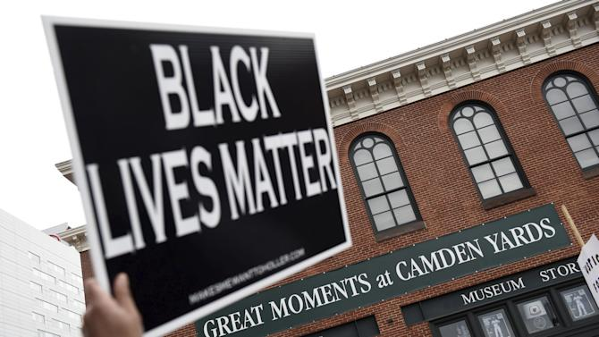 Demonstrators march to Camden Yards to protest against the death in police custody of Freddie Gray in Baltimore