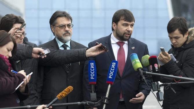 Pushilin, representative of the separatist self-proclaimed Donetsk People's Republic and Deinego, representative of the Luhansk republic, speak to the media at Minsk's International airport before peace talks in Minsk