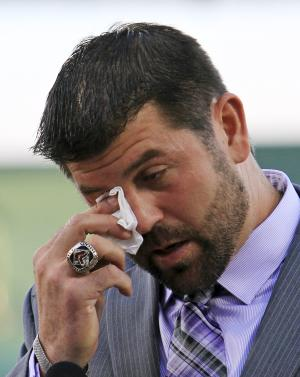 """Boston Red Sox catcher Jason Varitek wipes a tear during his baseball retirement announcement in Fort Myers, Fla., Thursday, March 1, 2012. Varitek says he grappled with the decision for a long time. The Red Sox offered the 39-year-old a chance to come to camp on a minor-league contract, but he declined. He says """"the hardest thing to do is walk away from your teammates."""" (AP Photo/Alan Diaz)"""
