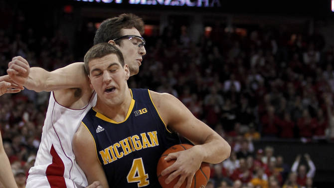 Michigan's Mitch McGary (4) drives against Wisconsin's Frank Kaminsky during the first half of an NCAA college basketball game Saturday, Feb. 9, 2013, in Madison, Wis. (AP Photo/Andy Manis)